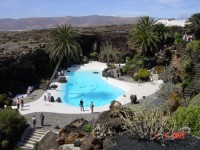 Lanzarote, a beautiful pool with palm trees