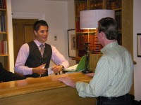 Hotel front desk, staff and guests