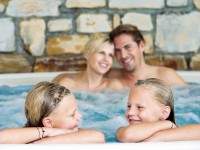 Family in a large jacuzzi
