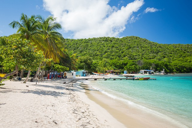 Salt Whistle Bay, one of St Vincent and The Grenadines most excellent beaches known for its sand, trees,resorts and waters ©Christian Lendl/flickr