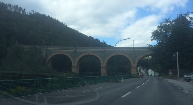 A bridge of the railway line seen from the car in Payerbach. Bridges and viaducts are very common in this region, representing the engineering of the railway