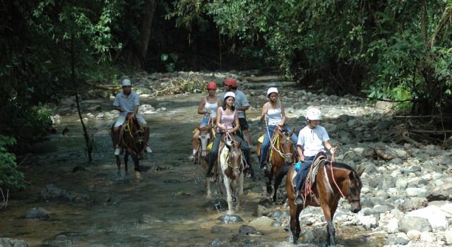 Jungle horseback riding at The Tulemar Resort